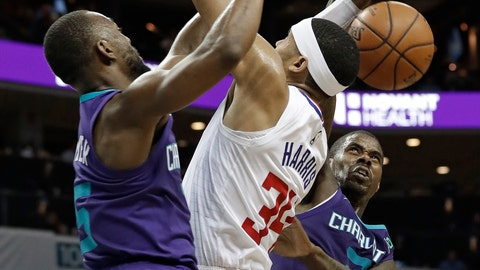 <p>               Los Angeles Clippers' Tobias Harris (34) is fouled as he drives between Charlotte Hornets' Kemba Walker, left, and Marvin Williams, right, during the second half of an NBA basketball game in Charlotte, N.C., Tuesday, Feb. 5, 2019. (AP Photo/Chuck Burton)             </p>