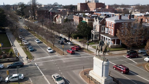 <p>               In this Jan. 27, 2019, traffic passes by the statue of Confederate General Stonewall Jackson at the intersection Traffic passes by the statue of Confederate General Stonewall Jackson at the intersection of Monument Avenue and The Boulevard in Richmond, Va. A city councilwoman and others are attempting to get the Boulevard named after tennis star Arthur Ashe. (AP Photo/Steve Helber)             </p>