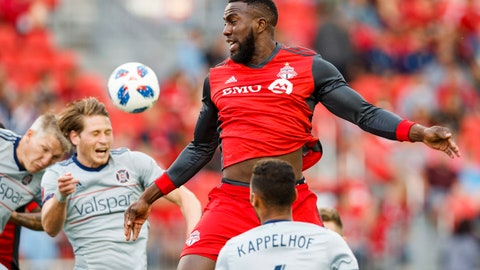 <p>               FILE - In this July 28, 2018, file photo, Toronto FC's Jozy Altidore leaps for the ball between Chicago Fire players, including Johan Kappelhof (4), during the first half of an MLS soccer match, in Toronto. Toronto FC confirmed Thursday, Feb. 28, 2019, that star striker Jozy Altidore is staying put. The 29-year-old U.S. international has signed a three-year contract extension that will keep him in Toronto through the 2022 season.(Mark Blinch/The Canadian Press via AP, File)             </p>