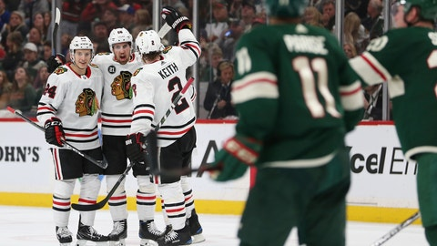 <p>               Chicago Blackhawks' Erik Gustafsson, middle, of Sweden, celebrates with teammates Dominik Kahun, left, of the Czech Republic, and Duncan Keith, right, after Gustafsson scored a goal against the Minnesota Wild during the second period of an NHL hockey game Saturday, Feb. 2, 2019, in St. Paul, Minn. (AP Photo/Stacy Bengs)             </p>