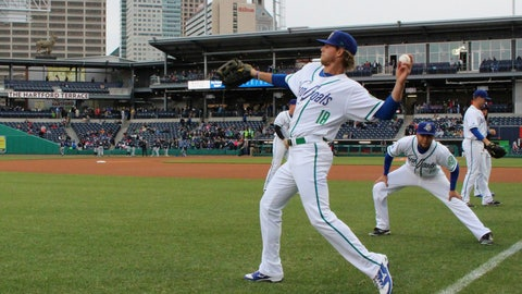 <p>               FILE - In this April 13, 2017 file photo, Hartford Yard Goats players warm up before the team's first ever game in Hartford, Conn. The Double-A team say they are going peanut-free at the 6,000-seat Dunkin' Donuts Park in 2019 to make the venue safer for people with nut allergies. (AP Photo/Pat Eaton-Robb, File)             </p>
