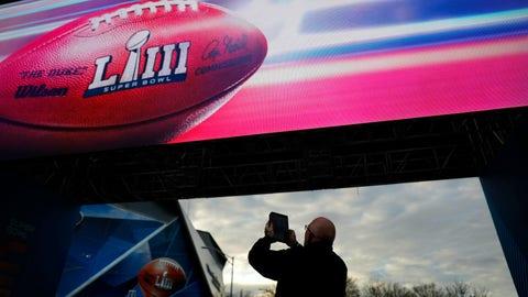 <p>               Frank Egdmann, of Kiel, Germany, takes a photo of Mercedes-Benz Stadium ahead of Sunday's NFL Super Bowl 53 football game between the Los Angeles Rams and New England Patriots in Atlanta, Saturday, Feb. 2, 2019. (AP Photo/David Goldman)             </p>