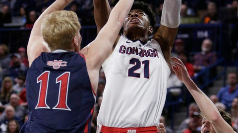 <p>               Gonzaga forward Rui Hachimura (21) shoots between Saint Mary's forward Matthias Tass (11) and guard Tanner Krebs (0) during the first half of an NCAA college basketball game in Spokane, Wash., Saturday, Feb. 9, 2019. (AP Photo/Young Kwak)             </p>