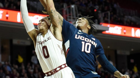<p>               Temple's Alani Moore II (0) and Connecticut's Brendan Adams reach for a loose ball during the first half of an NCAA college basketball game, Wednesday, Feb. 6, 2019, in Philadelphia. (AP Photo/Michael Perez)             </p>