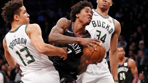 <p>               Milwaukee Bucks guard Malcolm Brogdon (13) and Bucks forward Giannis Antetokounmpo (34) double-team Brooklyn Nets forward Ed Davis (17) who gets sandwiched driving to the basket during the first half of an NBA basketball game, Monday, Feb. 4, 2019, in New York. (AP Photo/Kathy Willens)             </p>