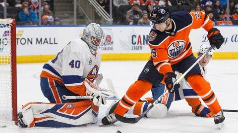 <p>               New York Islanders goalie Robin Lehner (40) makes a save against Edmonton Oilers' Alex Chiasson (39) as Islanders' Scott Mayfield (24) tries to defend during second-period NHL hockey game action in Edmonton, Alberta, Thursday, Feb. 21, 2019. (Jason Franson/The Canadian Press via AP)             </p>