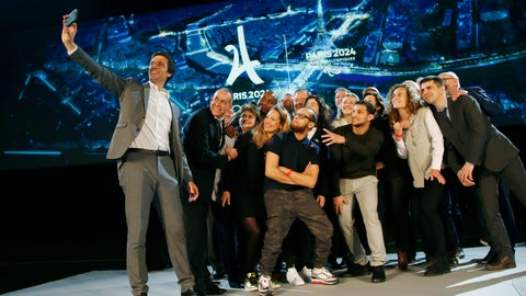 <p>               Paris 2024 Games' chief Tony Estanguet, left, makes a selfie with all invited guests after a media conference at La Defense business district, outside Paris, Thursday, Feb. 21 , 2019. The organizers of the 2024 Paris Olympics want to add breakdancing to the games, which would be a first for the dance sport that came from the streets of New York. Also on Paris' wish-list of events it wants to add to the program are climbing, surfing and skateboarding. (AP Photo/Michel Euler)             </p>