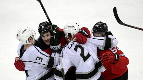<p>               Los Angeles Kings defensemen Dion Phaneuf (3) and Paul LaDue (2) scuffle with New Jersey Devils' Brian Boyle, second from left, an Kevin Rooney, right, at the end of an NHL hockey game Tuesday, Feb. 5, 2019, in Newark, N.J. The Kings won 5-1. (AP Photo/Julio Cortez)             </p>