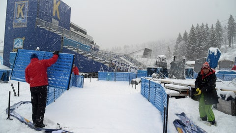 <p>               Race officials dismantle the course after an alpine ski, men's World Cup giant slalom was canceled due to weather conditions, in Garmisch Partenkirchen, Germany, Sunday, Feb. 3, 2019. (AP Photo/Marco Tacca)             </p>