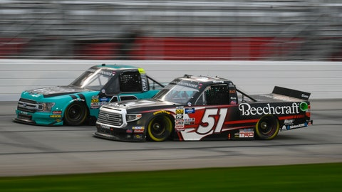 <p>               Kyle Busch (51) and Johnny Sauter run side by side during the NASCAR Truck Series auto race at Atlanta Motor Speedway, Saturday, Feb. 23, 2019, in Hampton, Ga. (AP Photo/John Amis)             </p>