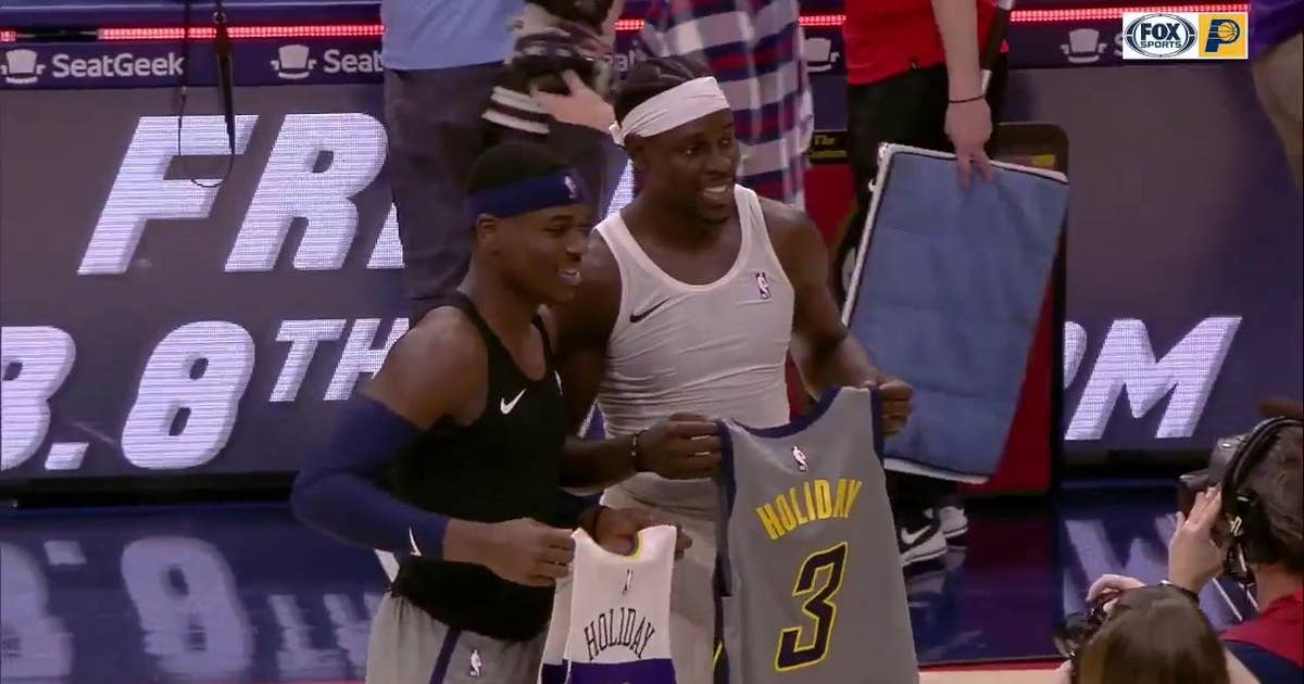3b8acded351 Aaron Holiday and brother Jrue Holiday exchange jerseys after game ...