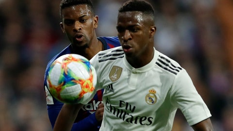<p>               Real forward Vinicius Junior, right, and Barcelona defender Nelson Semedo challenge for the ball during the Copa del Rey semifinal second leg soccer match between Real Madrid and FC Barcelona at the Bernabeu stadium in Madrid, Wednesday, Feb. 27, 2019. (AP Photo/Manu Fernandez)             </p>