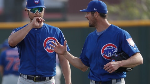 <p>               Chicago Cubs' Yu Darvish talks to Cole Hamels during a spring training baseball workout Friday, Feb. 15, 2019, in Mesa, Ariz. (AP Photo/Morry Gash)             </p>