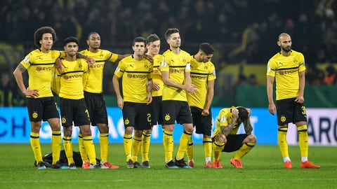 <p>               FILE -- In this Tuesday, Feb. 5, 2019 photo Dortmund's Paco Alcacer, 2nd from right, looks down after he missed to score the first penalty during the shootout at the German soccer cup, DFB Pokal, match between Borussia Dortmund and Werder Bremen in Dortmund, Germany. Borussia Dortmund hasn't had a run of five games without a win since Peter Bosz was in charge in 2017. On Sunday, the Dutch coach will attempt to prolong his former side's misery when his Bayer Leverkusen side visits the Bundesliga leaders for a game that could have serious implications for the title. (AP Photo/Martin Meissner, file)             </p>