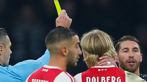 <p>               This Wednesday Feb. 13, 2019, image shows referee Damir Skomina, left, showing a yellow card to Real's Sergio Ramos, right, after a foul on Ajax's Kasper Dolberg during the first leg, round of sixteen, Champions League soccer match between Ajax and Real Madrid at the Johan Cruyff ArenA in Amsterdam, Netherlands. UEFA is investigating reported comments by Real Madrid captain Sergio Ramos that he intentionally got a yellow card to provoke a favorable Champions League ban. (AP Photo/Peter Dejong)             </p>