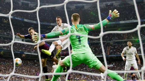 <p>               Barcelona goalkeeper Marc-Andre ter Stegen makes a save during the Copa del Rey semifinal second leg soccer match between Real Madrid and FC Barcelona at the Bernabeu stadium in Madrid, Wednesday, Feb. 27, 2019. Barcelona won 3-0. (AP Photo/Manu Fernandez)             </p>