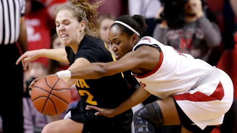 <p>               Iowa's Kathleen Doyle (22) attempts to steal the ball from Nebraska's Sam Haiby, right, during the first half of an NCAA college basketball game in Lincoln, Neb., Monday, Feb. 25, 2019. (AP Photo/Nati Harnik)             </p>