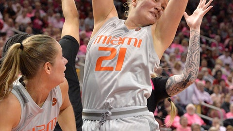 <p>               Miami forward Emese Hof (21) pulls down a rebound during the second half of an NCAA college basketball game against Louisville in Louisville, Ky., Sunday, Feb. 17, 2019. Miami won 79-73. (AP Photo/Timothy D. Easley)             </p>