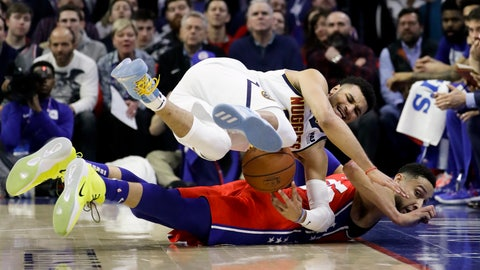 <p>               Denver Nuggets' Jamal Murray, top, and Philadelphia 76ers' Ben Simmons chase the ball during the first half of an NBA basketball game Friday, Feb. 8, 2019, in Philadelphia. (AP Photo/Matt Slocum)             </p>