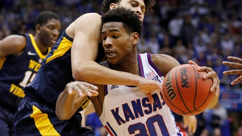 <p>               Kansas guard Ochai Agbaji (30) attempts to get past West Virginia guard Jermaine Haley (10)during the first half of an NCAA college basketball game, Saturday, Feb. 16, 2019, in Lawrence, Kan. (AP Photo/Colin E. Braley)             </p>