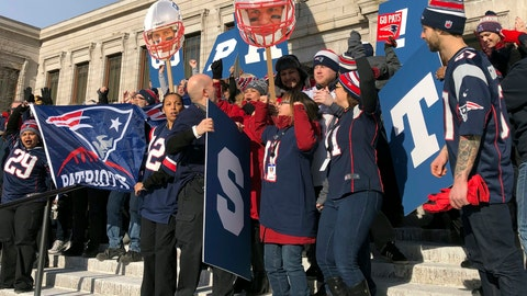 <p>               Workers at Boston's Museum of Fine Arts rally outside in New England Patriots garb on Friday, Feb. 1, 2019 in Boston. The museum and Los Angeles' J. Paul Getty Museum are trading a little trash talk ahead of the Super Bowl between the Patriots and the Rams. (AP Photo/Bill Kole)             </p>