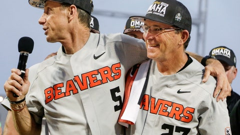<p>               In this June 28, 2018, photo, former Oregon State coach Pat Casey, left, celebrates with his associate head coach Pat Bailey, after beating Arkansas for the NCAA College World Series baseball championship, in Omaha, Neb. Bailey, now Oregon State's interim head coach, is taking over the program that won the 2018 national championship and 111 of its last 130 baseball games. The 63-year-old was an assistant to former coach Pat Casey for 11 years. The Beavers bring back most of their pitchers but must replace six everyday position players. (AP Photo/Nati Harnik)             </p>