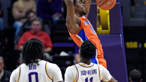 <p>               Florida center Kevarrius Hayes (13) dunks in front of LSU forwards Naz Reid (0) and Kavell Bigby-Williams (11) during the first half of an NCAA college basketball game Wednesday, Feb. 20, 2019, in Baton Rouge, La. (AP Photo/Bill Feig)             </p>