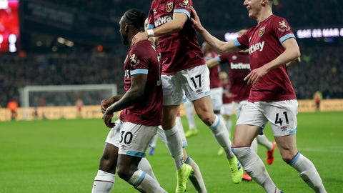 <p>               West Ham's Michail Antonio, left, celebrates with West Ham's Chicharito, centre, and West Ham's Declan Rice after scoring his side's first goal during the English Premier League soccer match between West Ham United and Liverpool at the London Stadium in London, Monday, Feb. 4, 2019.(AP Photo/Kirsty Wigglesworth)             </p>