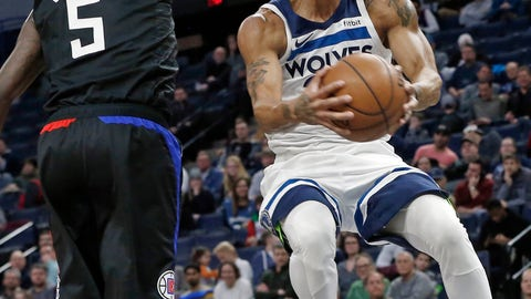 <p>               Minnesota Timberwolves' Derrick Rose, right, eyes the basket on a layup as Los Angeles Clippers' Montrezl Harrell defends in the first half of an NBA basketball game Monday, Feb. 11, 2019, in Minneapolis. (AP Photo/Jim Mone)             </p>