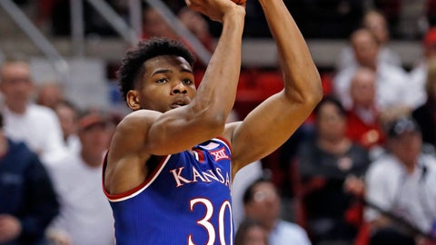 <p>               Kansas' Ochai Agbaji (30) shoots during the second half of the team's NCAA college basketball game against Texas Tech, Saturday, Feb. 23, 2019, in Lubbock, Texas. (AP Photo/Brad Tollefson)             </p>