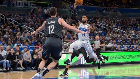 <p>               Orlando Magic guard D.J. Augustin (14) passes the ball while defended by Brooklyn Nets forward Joe Harris (12) during the first half of an NBA basketball game in Orlando, Fla., Saturday, Feb. 2, 2019. (AP Photo/Willie J. Allen Jr.)             </p>