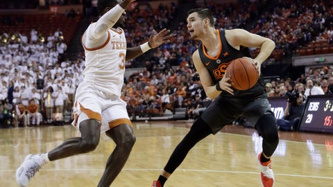 <p>               Oklahoma State guard Thomas Dziagwa (4) is pressured by Texas guard Courtney Ramey (3) during the first half of an NCAA college basketball game, Saturday, Feb. 16, 2019, in Austin, Texas. (AP Photo/Eric Gay)             </p>
