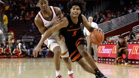 <p>               Oregon State 's Ethan Thompson, right, is defended by Southern California 's Elijah Weaver, left, during the first half of an NCAA college basketball game Saturday, Feb. 23, 2019, in Los Angeles. (AP Photo/Marcio Jose Sanchez)             </p>