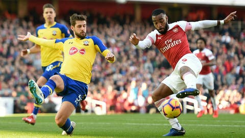 <p>               Southampton's Jack Stephens, left, and Arsenal's Alexandre Lacazette in action during their English Premier League soccer match at the Emirates Stadium in London, Sunday Feb. 24, 2019. (Joe Giddens/PA via AP)             </p>