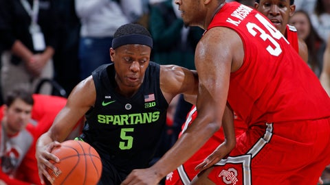 <p>               Michigan State's Cassius Winston, left, drives against Ohio State's Kaleb Wesson during the first half of an NCAA college basketball game, Sunday, Feb. 17, 2019, in East Lansing, Mich. (AP Photo/Al Goldis)             </p>