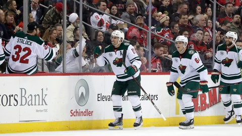 <p>               Minnesota Wild left wing Zach Parise, center, celebrates his second period goal against the New Jersey Devils during an NHL hockey game, Saturday, Feb. 9, 2019, in Newark, N.J. (AP Photo/Julio Cortez)             </p>