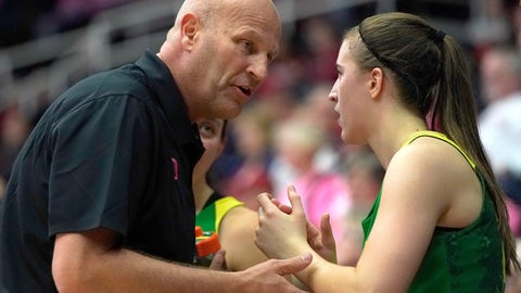 <p>               Oregon head coach Kelly Graves, left, talks with guard Sabrina Ionescu (20) on the bench during the second half  in an NCAA college basketball game against Stanford, Sunday, Feb. 10, 2019, in Stanford, Calif. Oregon won 88-48. (AP Photo/Tony Avelar)             </p>