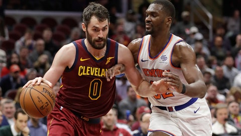<p>               Cleveland Cavaliers' Kevin Love (0) drives past New York Knicks' Noah Vonleh (32) in the first half of an NBA basketball game, Monday, Feb. 11, 2019, in Cleveland. (AP Photo/Tony Dejak)             </p>