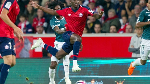 <p>               FILE - In this Saturday, Sept. 22, 2018 file photo, Lille's Nicolas Pepe, center, controls the ball during the French League One soccer match against Nantes at the Lille Metropole stadium, in Villeneuve d'Ascq, northern France.  Lille forward Nicolas Pepe is the French league's new sensation, and he knows his status has changed because of the way defenders react to him. (AP Photo/Michel Spingler, FILE)             </p>