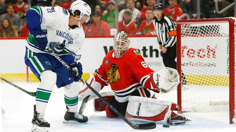 <p>               Chicago Blackhawks goaltender Collin Delia (60) stops a shot by Vancouver Canucks left wing Loui Eriksson (21) during the first period of an NHL hockey game Thursday, Feb. 7, 2019, in Chicago. (AP Photo Nuccio DiNuzzo)             </p>