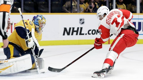 <p>               Detroit Red Wings center Andreas Athanasiou (72) shoots against Nashville Predators goaltender Pekka Rinne (35), of Finland, during the first period of an NHL hockey game Tuesday, Feb. 12, 2019, in Nashville, Tenn. (AP Photo/Mark Humphrey)             </p>