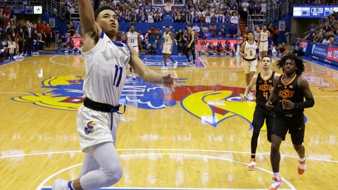 <p>               Kansas' Devon Dotson (11) puts up a shot during the first half of an NCAA college basketball game against Oklahoma State Saturday, Feb. 9, 2019, in Lawrence, Kan. (AP Photo/Charlie Riedel)             </p>