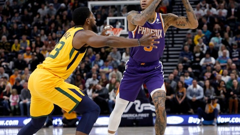 <p>               Phoenix Suns' Kelly Oubre Jr., right, looks to pass as Utah Jazz's Royce O'Neale, left, defends in the first half of an NBA basketball game on Wednesday, Feb. 6, 2019, in Salt Lake City. (AP Photo/Kim Raff)             </p>