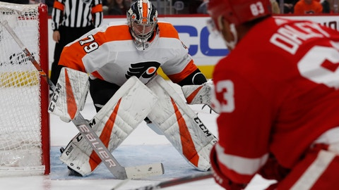 <p>               Detroit Red Wings defenseman Trevor Daley (83) shoots towards Philadelphia Flyers goaltender Carter Hart (79) during the second period of an NHL hockey game, Sunday, Feb. 17, 2019, in Detroit. (AP Photo/Carlos Osorio)             </p>
