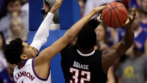 <p>               Kansas forward Dedric Lawson (1) blocks a shot by Texas Tech center Norense Odiase (32) during the first half of an NCAA college basketball game in Lawrence, Kan., Saturday, Feb. 2, 2019. (AP Photo/Orlin Wagner)             </p>