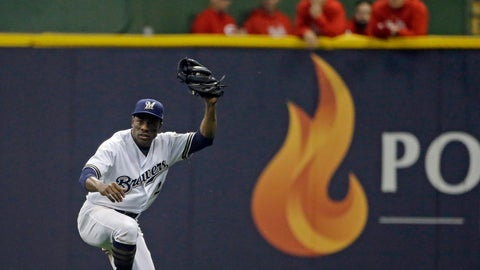 <p>               FILE - In this Sept. 18, 2018 file photo, Milwaukee Brewers' Curtis Granderson raises his glove after making a sliding catch in the outfield during the fifth inning of a baseball game against the Cincinnati Reds in Milwaukee. Granderson has agreed to a minor league contract with the Miami Marlins and will report to big league spring training. If added to the 40-man roster, he would get a one-year contract that pays $1.75 million while in the major leagues and have the chance to earn $250,000 in performance bonuses for plate appearances. (AP Photo/Aaron Gash, File)             </p>