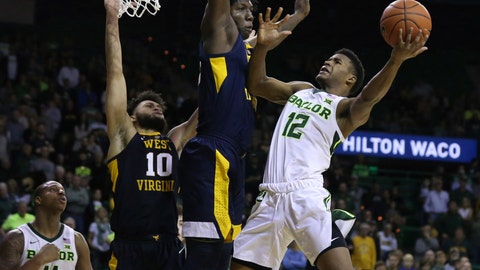 <p>               Baylor guard Jared Butler, right, attempts a shot over West Virginia forward Andrew Gordon, left, in the first half of an NCAA college basketball game, Saturday, Feb. 23, 2019, in Waco, Texas. (Rod Aydelotte/Waco Tribune-Herald via AP)             </p>