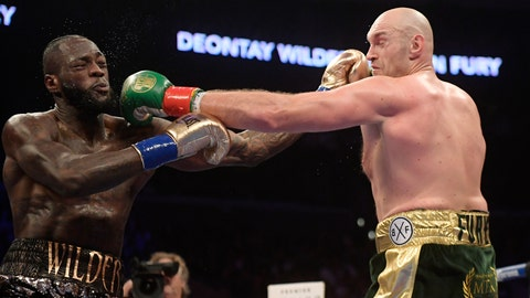 <p>               File-This Dec. 1, 2018, file photo shows Deontay Wilder, left, and Tyson Fury, of England, trading punches during a WBC heavyweight championship boxing match in Los Angeles. The WBC heavyweight title rematch between champion Wilder and Fury is off for now. The two fought to a draw in December and were negotiating a rematch. But WBC President Mauricio Sulaiman said Tuesday, Feb. 26, 2019, he received confirmation from Fury that the challenger would look elsewhere for his next bout. (AP Photo/Mark J. Terrill, File)             </p>
