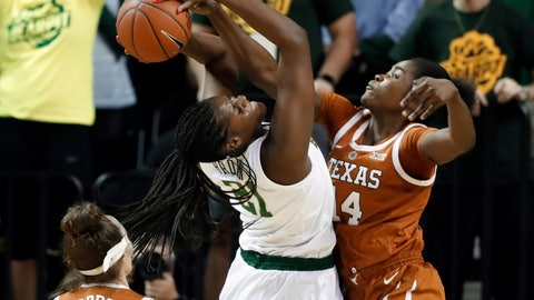 <p>               Texas guard Audrey Warren (31) watches as Baylor center Kalani Brown (21) works to take a shot while forward Olamide Aborowa (14) defends in the first half of an NCAA college basketball game in Waco, Texas, Monday, Feb. 25, 2019. (AP Photo/Tony Gutierrez)             </p>