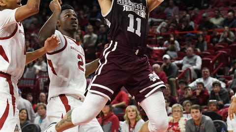 <p>               Mississippi State guard Quinndary Weatherspoon (11) drives past Arkansas defenders Isaiah Joe and Adrio Bailey (2) during the second half of an NCAA college basketball game Saturday, Feb. 16, 2019, in Fayetteville, Ark. (AP Photo/Michael Woods)             </p>